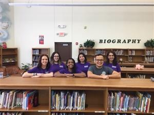 2nd grade staff lined up in a row