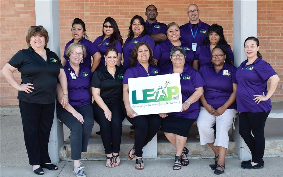 LEAP group photo with LEAP logo sign