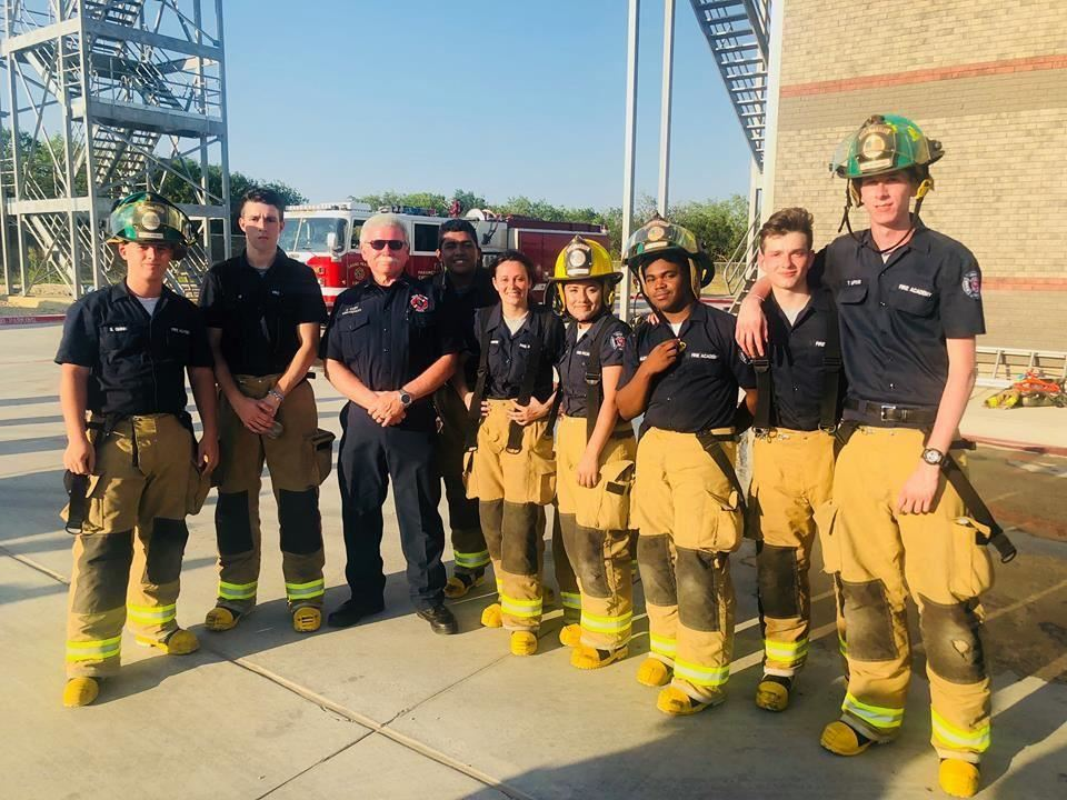 Gopher Fire Academy students standing with GPFD Lieutenant Sam Cary.