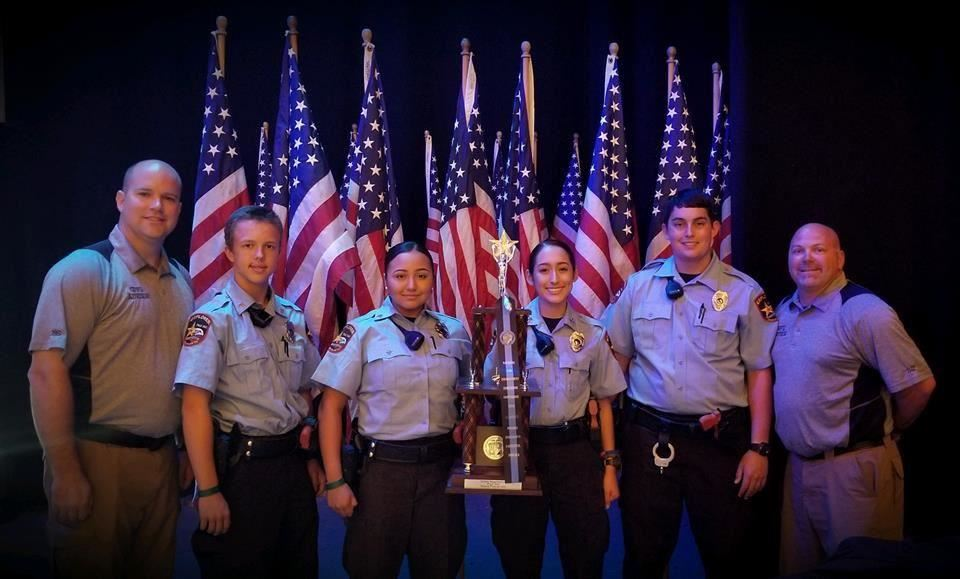 Gopher Law Enforcement students posing with first place trophy from national competition.
