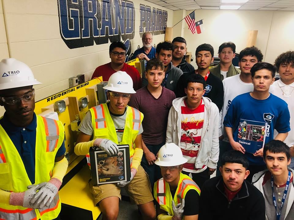 Gopher Electrical Engineer pathway students gather for a group picture around one of their residential wiring practice boards