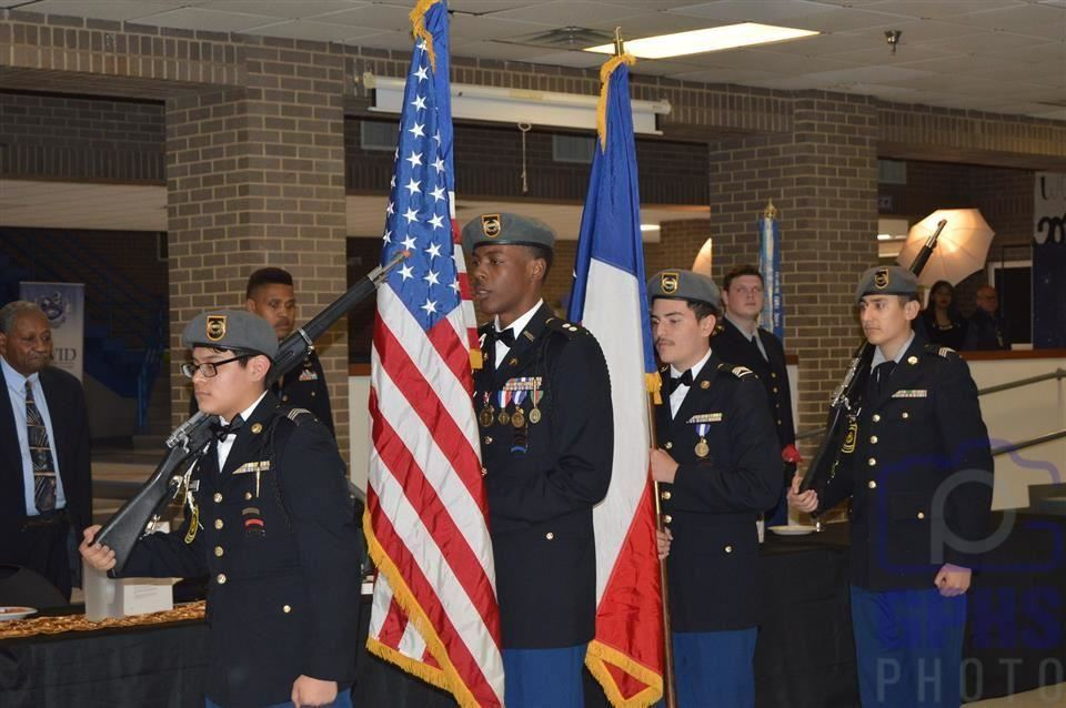 Gopher Battalion JROTC Color Guard carrying American and Texan flags.