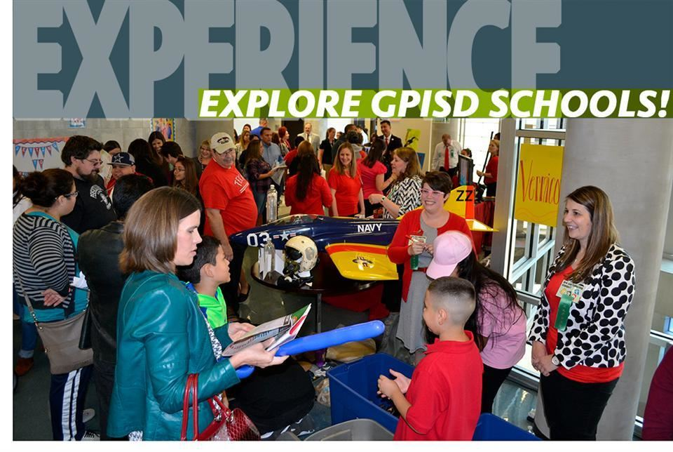 image of large crowd; families talking with principles tagline reads Experience - Explore GPISD Schools!