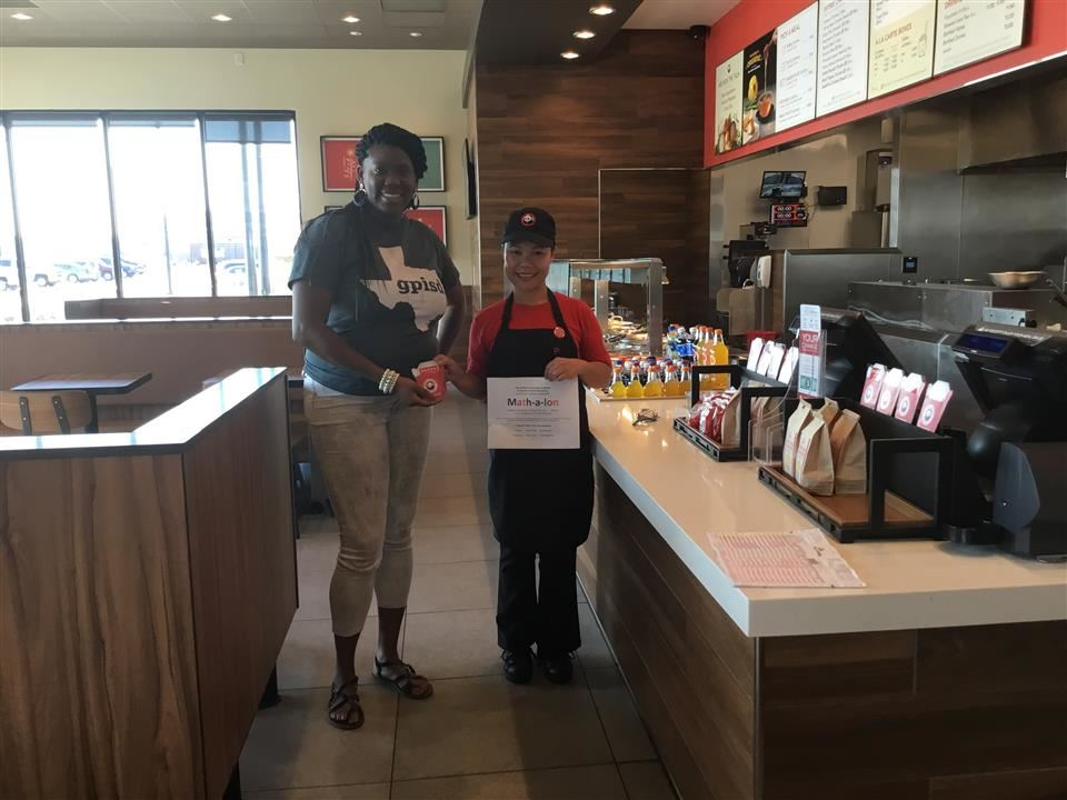 Latonya Herbert with a representative from Panda Express