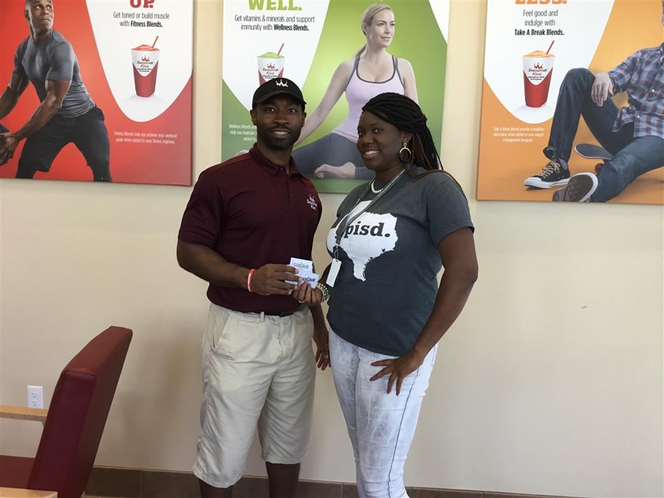 Latonya Herbert with representative from Smoothie King