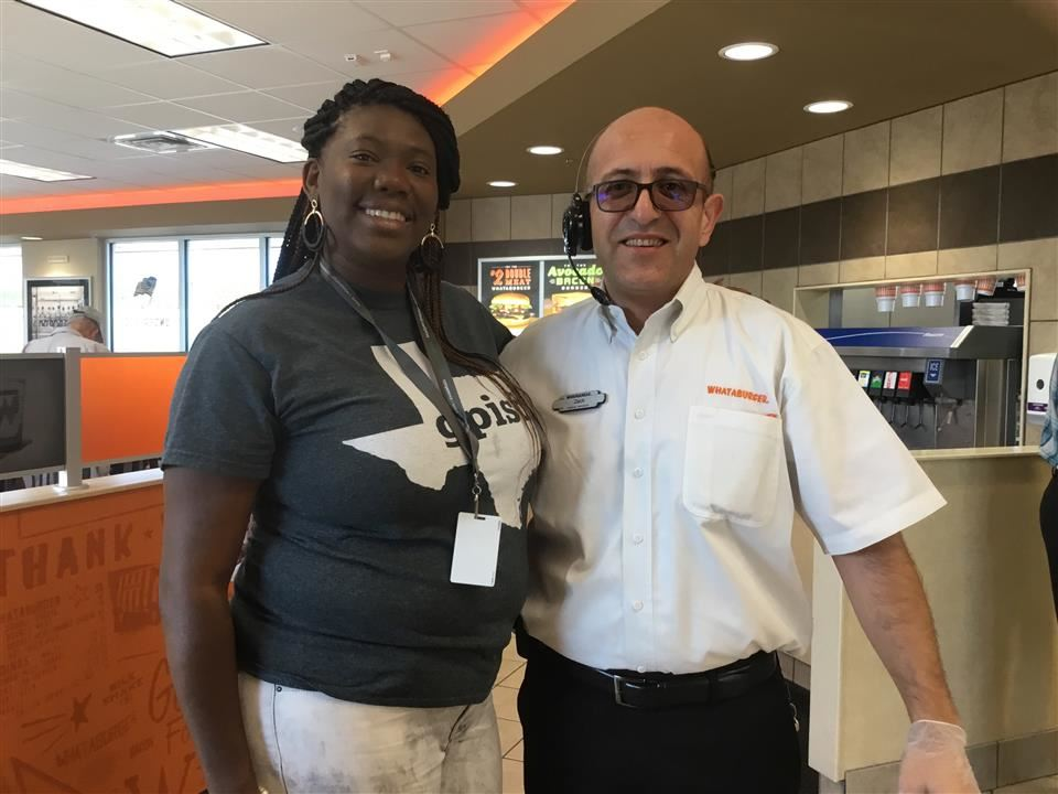 Latonya Herbert with a representative from Whataburger