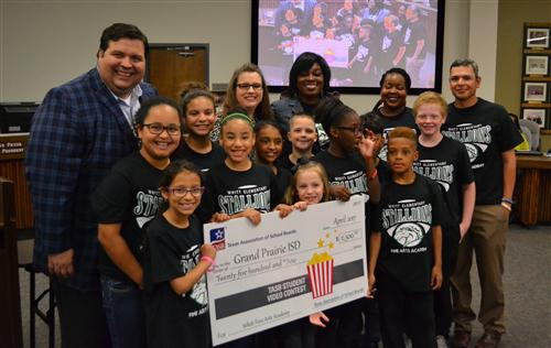 Whitt Fine Arts Academy with Check from TASB for Student Video Contest