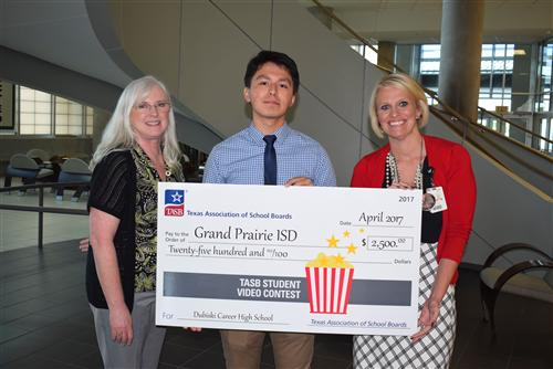 Dubiski student, media teacher and principal with check for TASB student video contest
